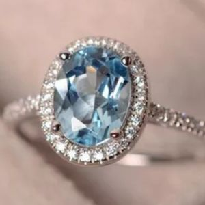 SILVER BLUE AND WHITE TOPAZ OVAL SHAPED HALO RING